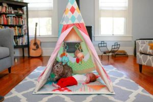 baby in play tent